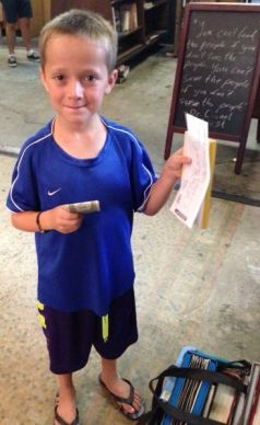 Lyle proudly shows receipt for selling three of his own books to The Last Bookstore -- and he then turned right around and bought $3 worth of new books!